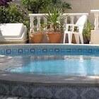 Een zwembad in de eigen tuin huis en tuin tuin for Eigen zwembad in de tuin